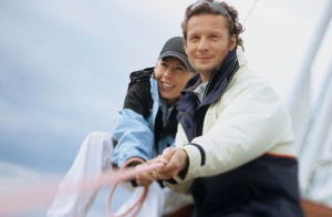 Couple on boat pulling rope
